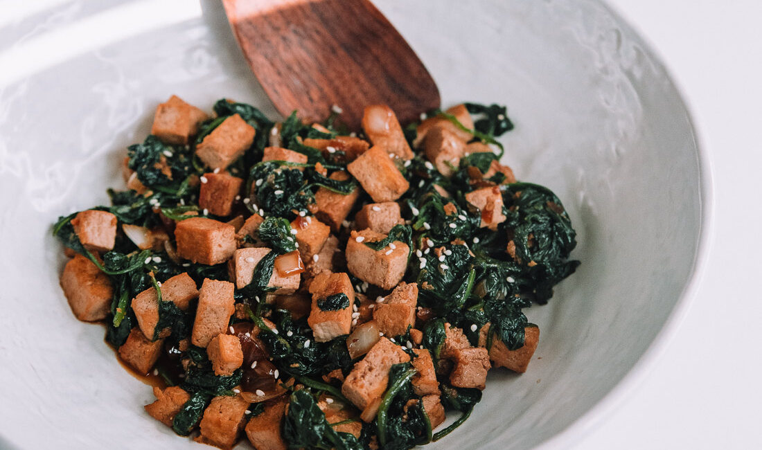 Spinach and Tofu Stir Fry in a large bowl ready to serve.