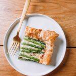 Spring Asparagus Tart on white plate with gold fork