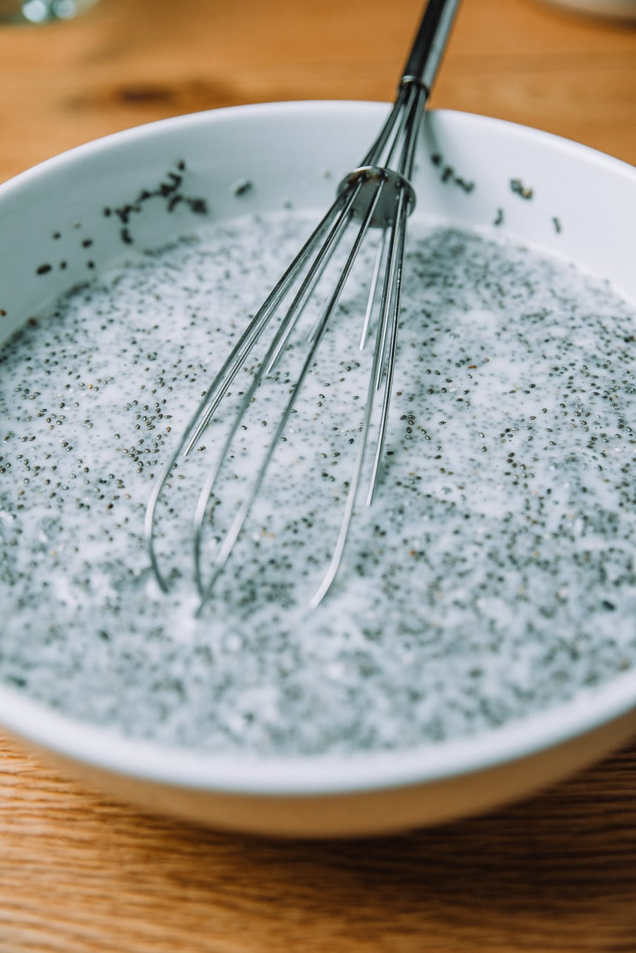 White bowl with milk and chia seeds