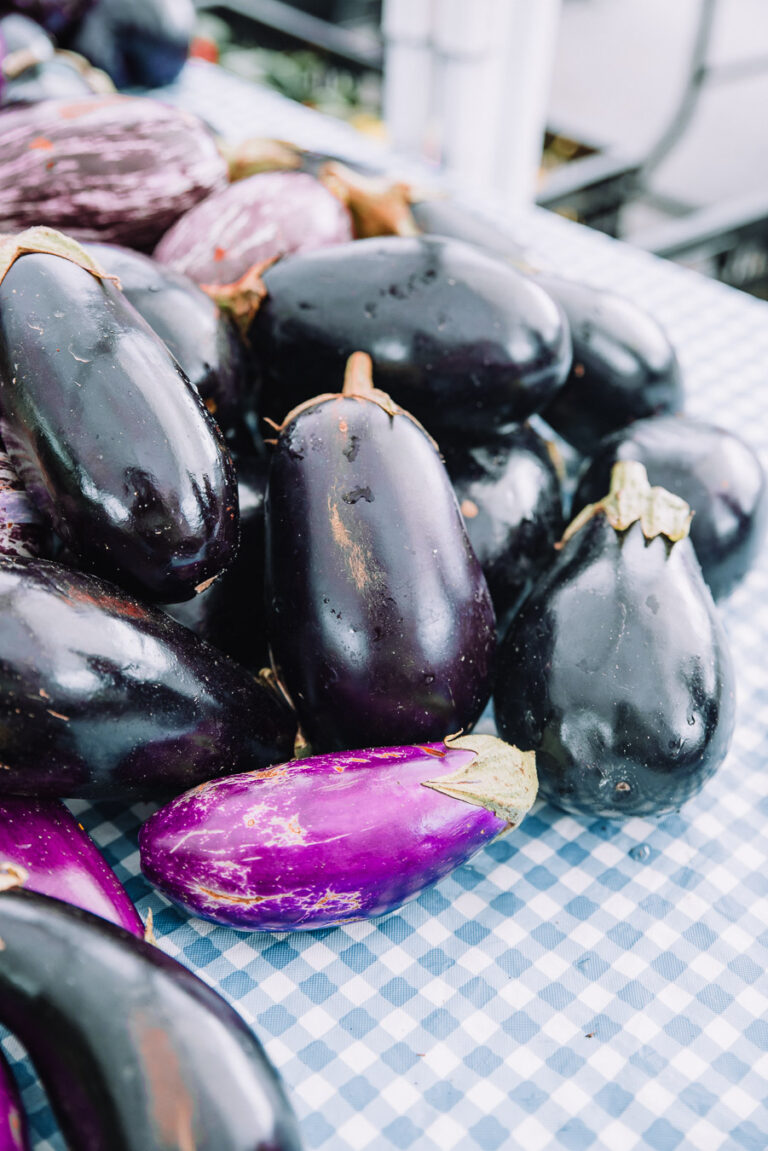 Eggplant on a table with blue plaid tabletop