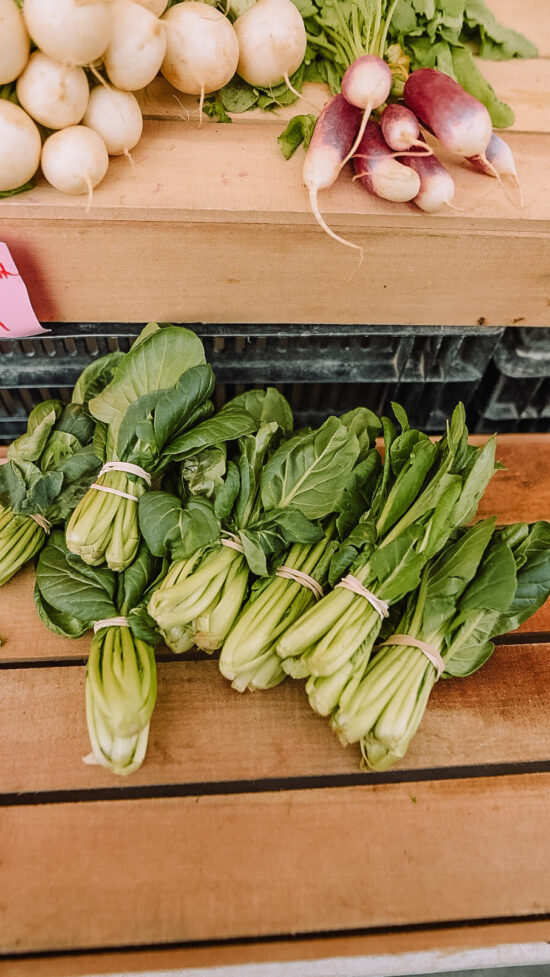 Baby Bok Choy on a wooden crate